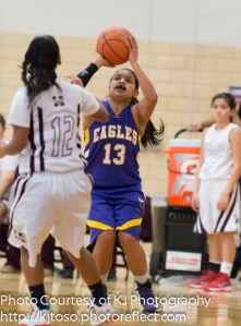Brackenridge senior guard Breeann Hernandez (13) releases a shot as Highlands' Erin Caldera (12) closes in.