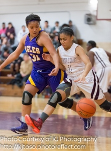 Highlands guard Kiara Pesina (1) tries to fend off Brackenridge's Skyler Reyna (31).