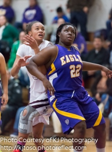 Brackenridge sophomore Marquanique Freeman (22) battles for position inside against Highlands' Jazzmine Jackson (33).