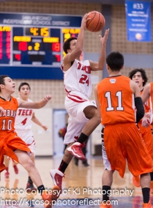 Fox Tech's Angel Lopez (24) drives to the hoop.