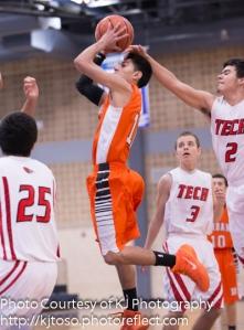 Burbank's Gabriel Rangel aims for a basket, despite the block attempt.
