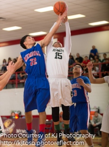 Memorial's Daniel Flores (22) tries to knock a rebound away from Kennedy's Vincent Rios (15).