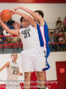 Kennedy junior Isaac Castro (21) hauls in a rebound against Memorial.