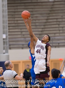Highlands' JerMichael Shirley skies to win the opening tip vs. Lanier.
