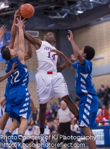 Jefferson's D'Andre Melton (14) fights for a rebound against two Lanier players.