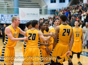 His East Central teammates celebrate Jeremy Jones' game-winning dunk.