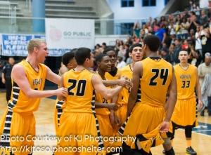 His East Central teammates celebrate Jeremy Jones' game-winning dunk.