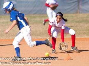 Bridget Gomez (7) locks in on the path of the grounder as a South San runner takes off on contact.