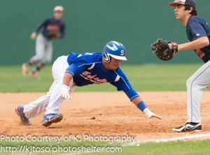 South San junior Frank Bosmans dives back to the bag to beat a Brandeis pickoff attempt.