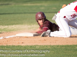 Highlands' Joshua Ortega slides into third base and looks back for the call in a NEISD Tournament game against Taft.