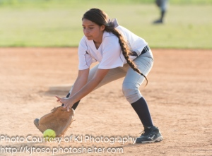 Providence infielder Kirstyn Garcia scoops up a grounder.