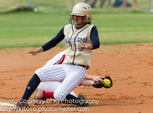 Knights senior pitcher Julia Ibarra beats the throw and arrives safely at second base.