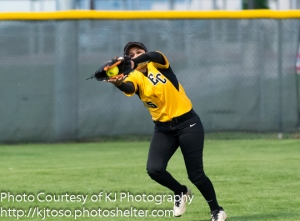 East Central left fielder Angel Lopez hauls in Amanda Sanchez's drive to end the fourth inning.