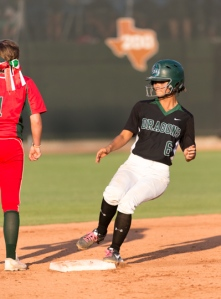 Southwest senior Gabby Flores rounds second base on her fourth-inning RBI double, while a Highlanderfs player awaits the throw from center field.