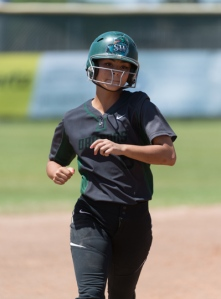 Gabby Flores heads for third base on her way to home plate after hitting a three-run home run.