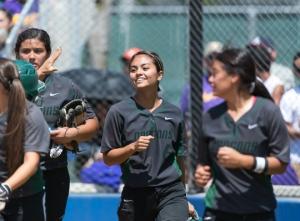 Teammates congratulate Gabby Flores after her three-run home run in the third inning.
