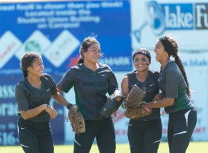 Kristal Salinas, Faith Aguilar, Amanda Sanchez and Yanira Fernandez (from left to right) share their enthusiasm over a remarkable catch. Salinas backpedaled to the outfield grass to corral the ball, but it popped out of her glove. Sanchez caught the ball in the air for the key out in the sixth inning.