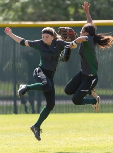 Southwest center fielder Liz Phillips and right fielder Faith Aguilar in their pre-inning ritual, before the seventh inning in Game 2.