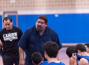 Joseph Martinez (left), who played on Lanier's 2000 and 2001 state teams, will succeed his mentor Rudy Bernal (right) as Lanier's boys basketball coach.