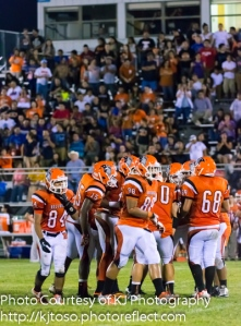 Burbank breaks the huddle in a 2013 game against Highlands.