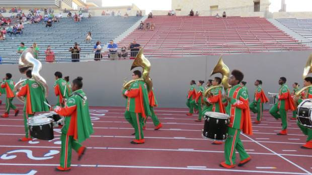 The outstanding Sam Houston band marches in as part of the Alamo Stadium re-dedication ceremony.