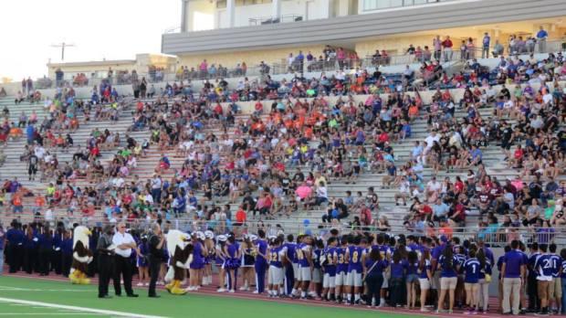 Brackenridge's contingent sings the school song at the Alamo Stadium re-dedication ceremony.