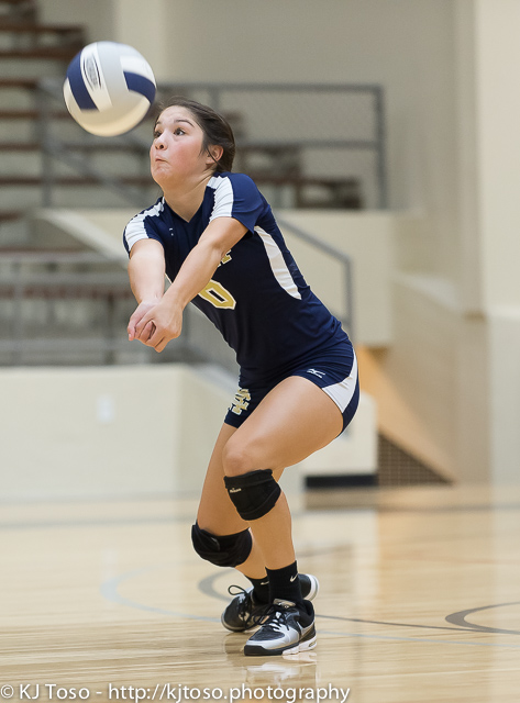 Holy Cross sophomore libero Daisy Flores executes a pass.