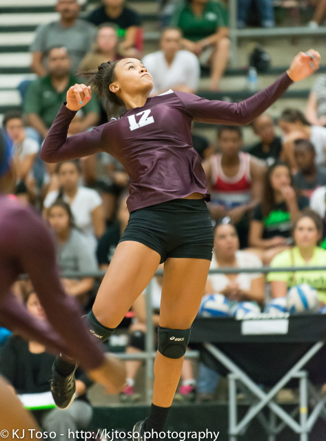 Jazmine Jackson, a powerful hitter for Highlands, goes up to punch one of her 8 kills.