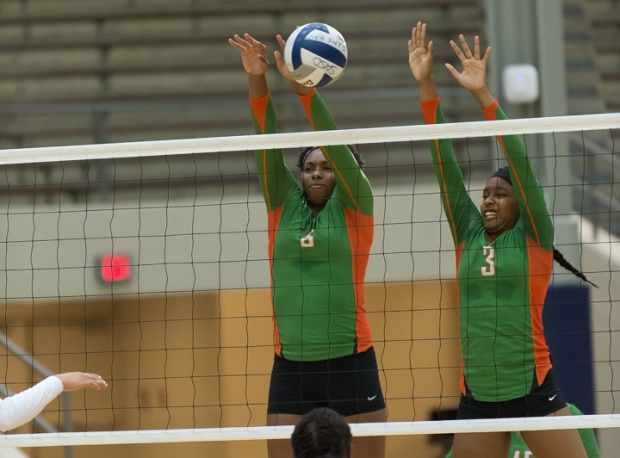 Karisma Mitchell (8) and Natalie Coburn (3) go up for a block against Burbank