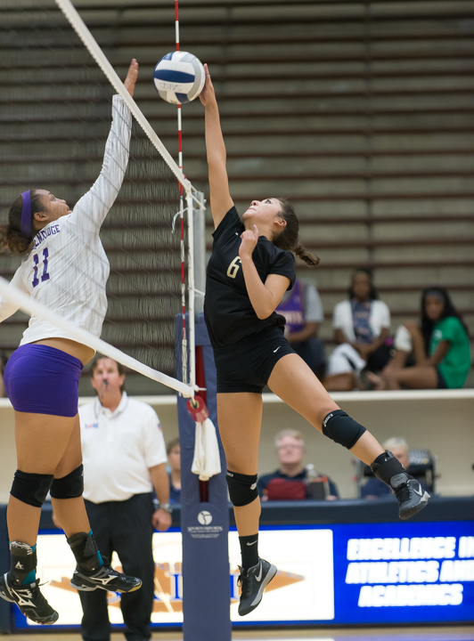 Edison's Marissa Cortinas (6) goes up for a kill against Brackenridge's Skyler Reyna (11) in a Sept. 30 match at Alamo Convocation Center.