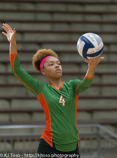 Sam Houston setter Rita Davis serves against Highlands.