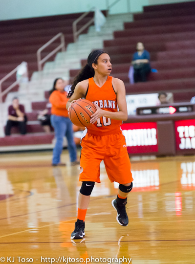 Burbank sophomore Jade Moore looks for an open teammate.