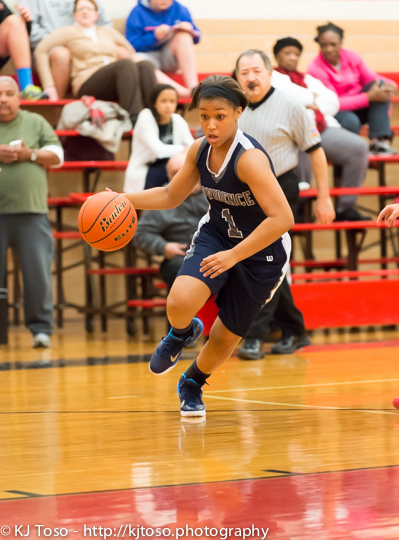 Providence's Imani Dunn-Lee looks for a driving lane against Fox Tech.