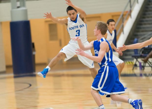 South San guard Justin Apolinar goes airborne to cut down MacArthur standout Kyle Murphy's passing lanes in a Thursday first-round game.