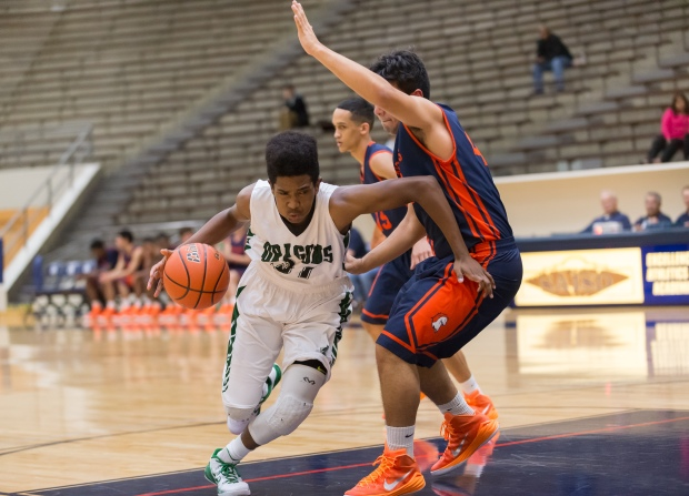Southwest freshman D'Andre Griffin drives on a Brandeis defender in a previous game.