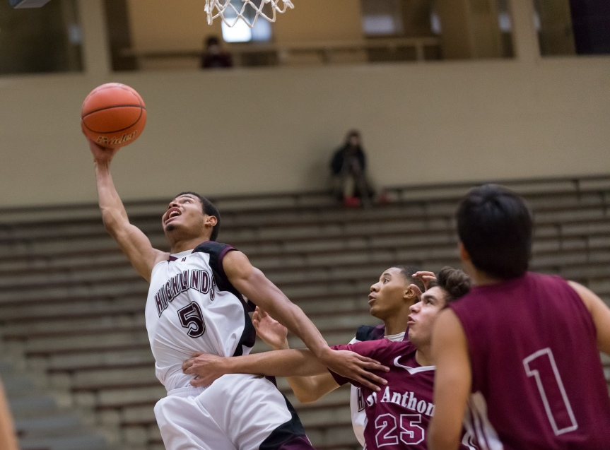 Highlands post Joseph Jackson corrals a rebound with one hand vs. St. Anthony.
