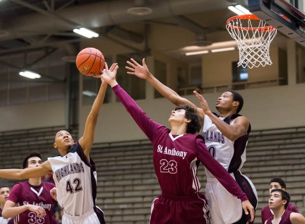 Highlands' Christopher Hartfield (42) tips a rebound away from St. Anthony's Asa Meyer (23).
