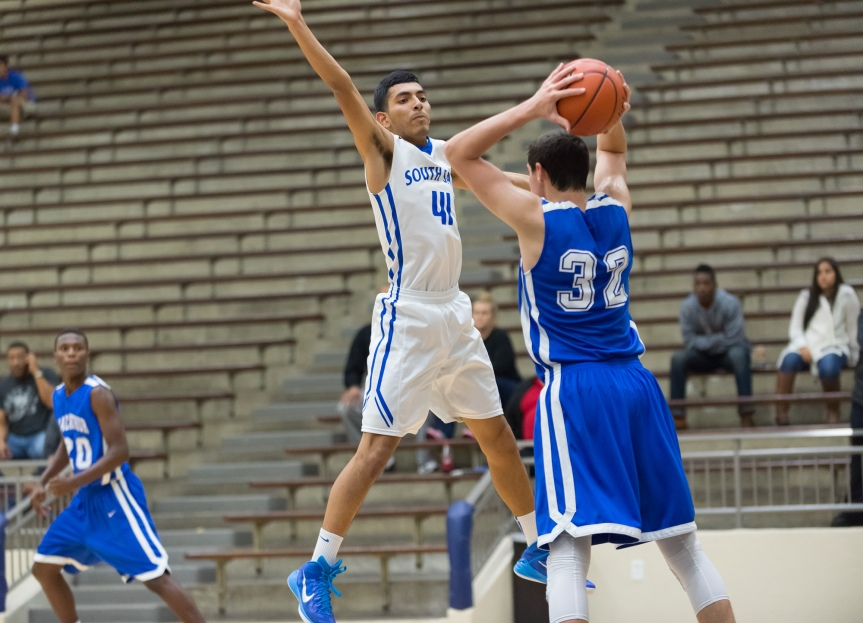 Joseph Zepeda (41) of South San defends an inbound pass from MacArthur's Shawn Hamilton.