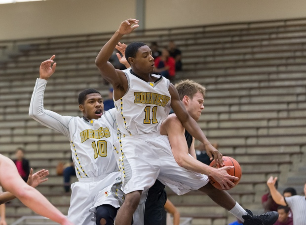 East Central's Greg White (11) and Ethan White (10) crash the boards against Clark in a SAISD Tournament semifinal.