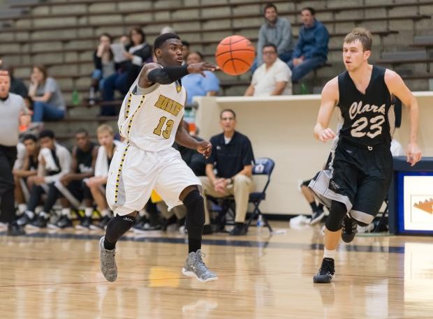 Hornets senior guard Wanya Ward (13) sends a pass ahead on the fastbreak. Ward scored 10 points against Clark.