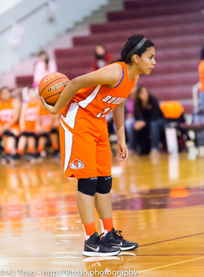 Bulldogs point guard Abigail Macias surveys the defense.