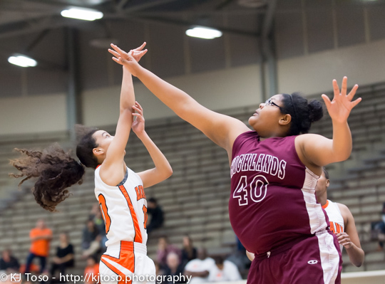 Highlands post Susana Stephens (40) goes after a shot from Burbank guard Jade Moore (10).