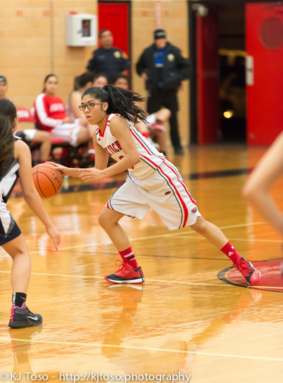 Fox Tech guard Melanie Molina looks for a passing lane.