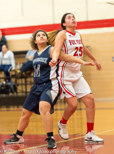 Fox Tech's Mercedes Villarreal (25) and Providence's Natalie Beauchamp (44) battle for rebounding position.