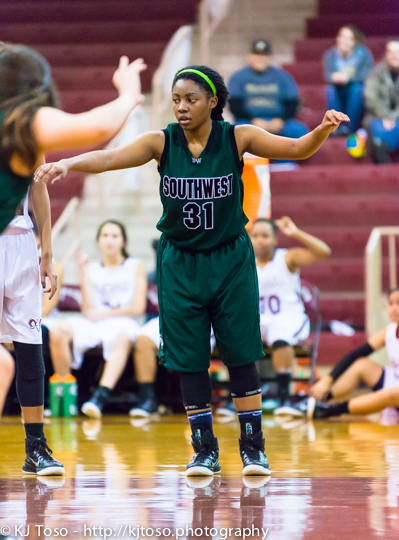 Aaliyah Holmes takes  a defensive stance in the tournament game against Marshall. Holmes finished with 13 points, 5 assists and 5 steals.