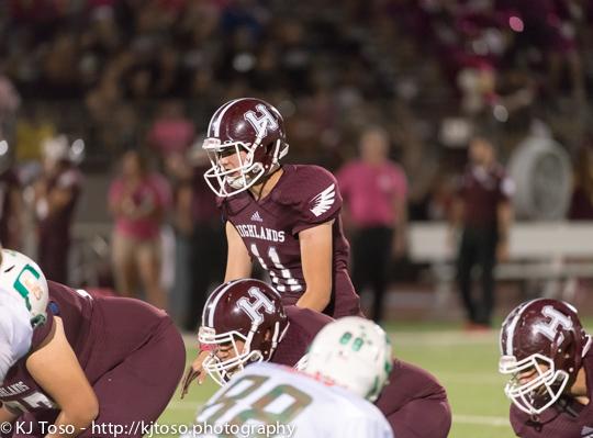 Highlands junior quarterback Dylan Camacho (11) surveys the defense.