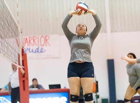Providence's Alyssa Tijerina (8) sets a teammate.